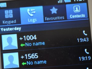 Phone scrren with call log, showing +1004 and +1565